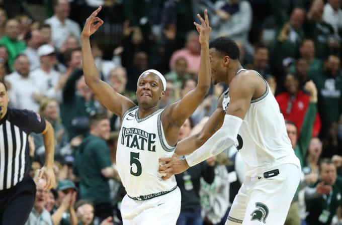 EAST LANSING, MICHIGAN - MARCH 08: Cassius Winston  5 of the Michigan State Spartans celebrates a second half three pointer with Xavier Tillman Sr.  23 while playing the Ohio State Buckeyes at the Breslin Center on March 08, 2020 in East Lansing, Michigan. Michigan State won the game 80-69. (Photo by Gregory Shamus/Getty Images)